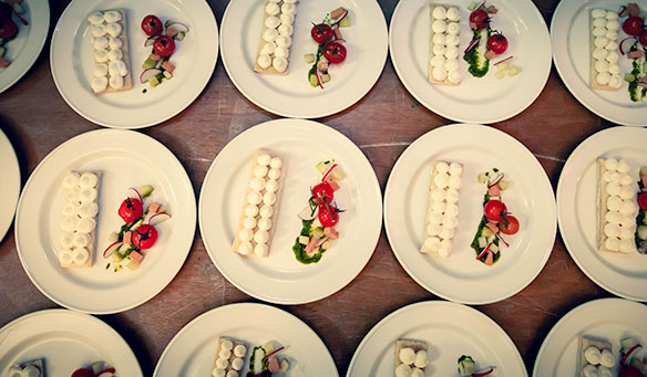 multiple starters laid out on a table in the middle of plating up