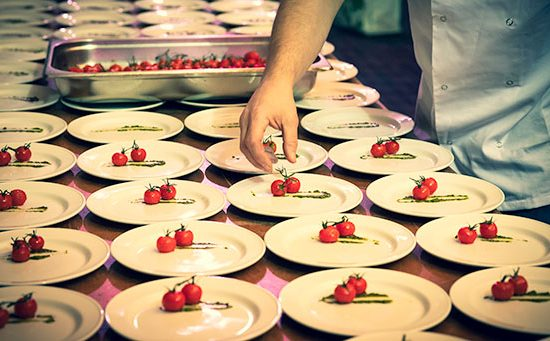 Plating up starters at a corporate function.